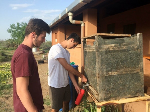 Figure 9 Group number 4; students testing an existing charcoal chilling water tank used in the school facilities